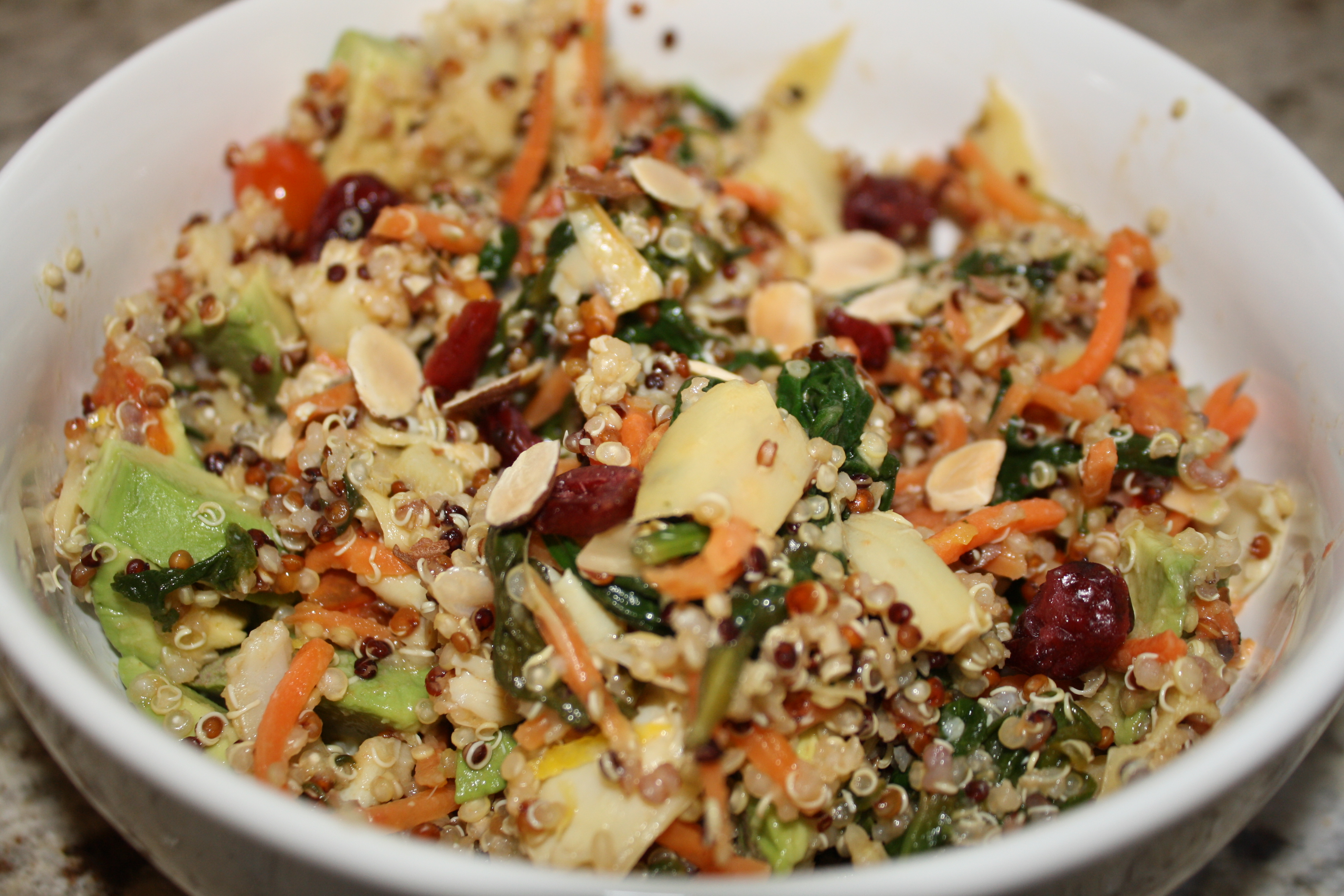 Tri Color Quinoa Salad with Veggies, Avocado, Cranberries and Almonds